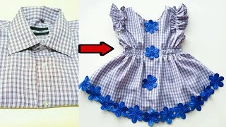 Tailoring a child 's dress from an old men' s shirt is stylish with all simplicity