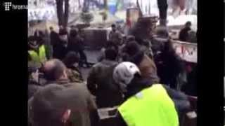 Ukrainian  pro-EU fascists  take out a dead body in the package from the Palace of Trade Unions.