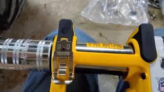 Loading a Dewalt Baтtery powered Grease gun