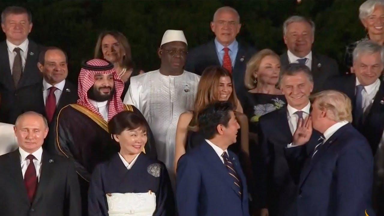 Download القادة المشاركون في قمة مجموعة العشرين أثناء التقاط صورة تذكارية في قلعة أوساكا باليابان