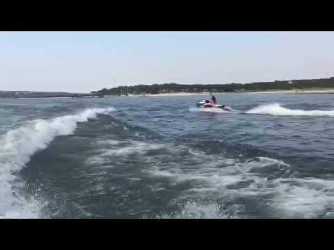 Sea Doo wave jumping behind 50 ft sea ray (Major Air)