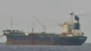 Navy takes control of hijacked oil tanker
