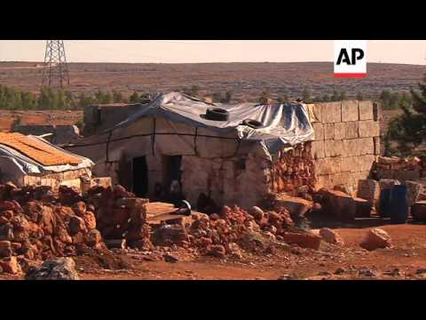 Dozens of families in Syria's north shelter from bombing in Roman ruins