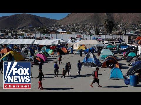 Tucker reacts to caravan migrants breaching US border