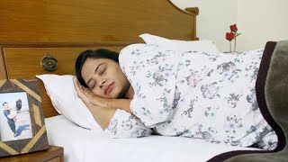 Beautiful pregnant woman feeling restless and uneasy while sleeping in her bed