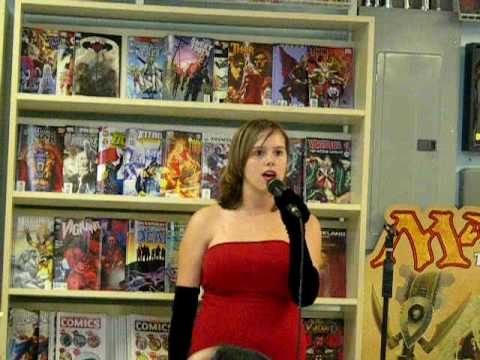 Comic shop karaoke: Cate does Somewhere In The Night at Docking Bay 94