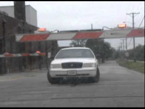 City car going around railroad crossing