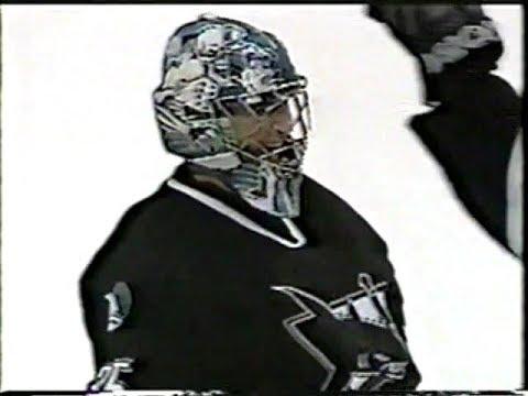 Goalie Evgeni Nabokov ( San Jose Sharks ) scores a goal against Canucks 2002