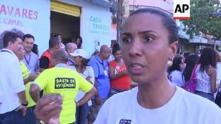 Hundreds protest over violence in Rio favelas
