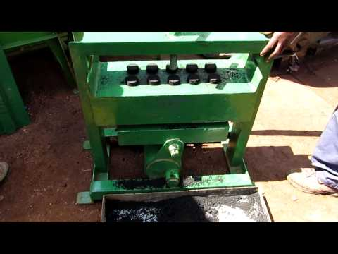 Manual charcoal briquette maker - 10 at a time with a lever