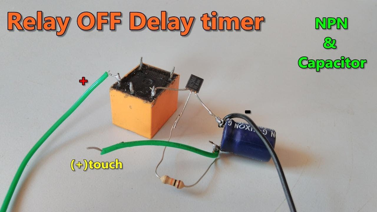 relay off time delay timer by using npn transistor and capacitor [ 1280 x 720 Pixel ]