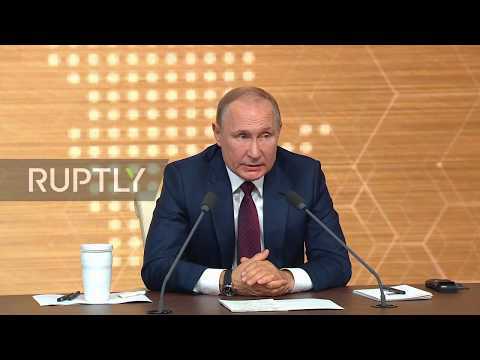 Russia: Putin Dismisses Question About Moscow's Role In Libya Conflict