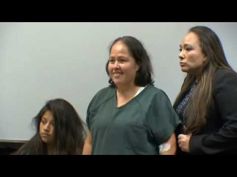 Woman accused of fatally stabbing husband, 4 children appears in court
