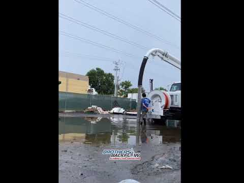 Flooded parking area holding several thousand gallons of rain water in Miami