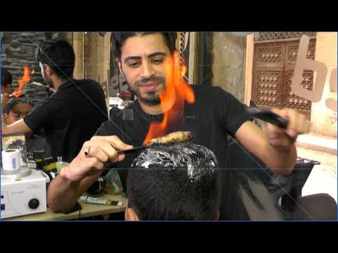 """EGYPT    Egyptian barber uses unusual """"fire"""" technique in cutting men's hair"""