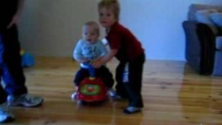 Kobe and Cooper and his Elmo Bike