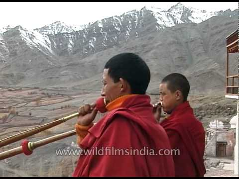 Buddhist monks playing dungchen at Dhankar Gompa