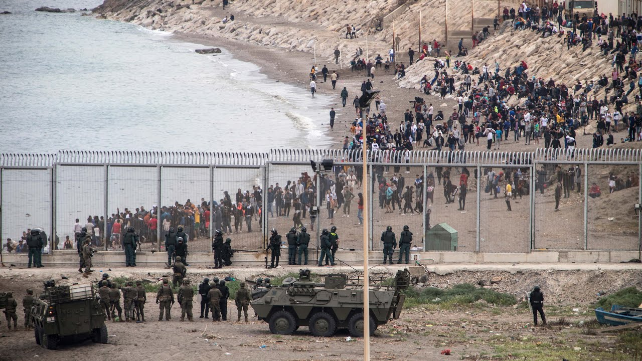 Ceuta: Children among thousands of migrants in desperate swim from Morocco to Spanish enclave