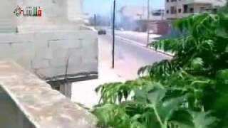 Homs, Syria, spraying bullets from tanks on the buildings - only happens in Syria