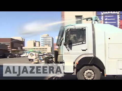 Zimbabwe: Riot police fire tear gas, water cannon at protesters
