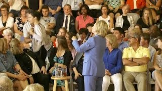 clinton confronted by hecklers at town hall