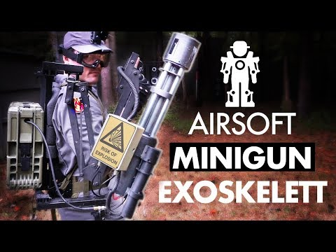 EXOSKELETT GUY DUAL WIELDS MINIGUN