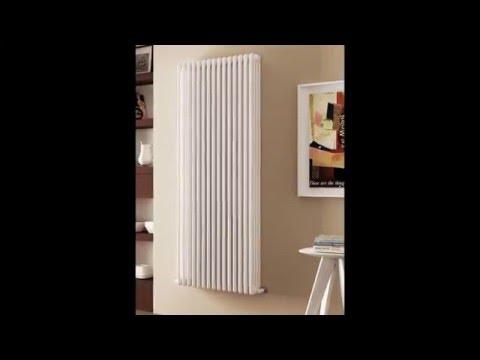 Белые полотенцесушители и радиаторы.