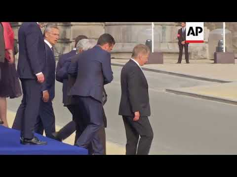 EU leader Juncker stumbles, loses balance several times ahead of NATO dinner