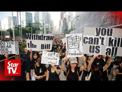 \'Sea of black\' Hong Kong protesters demand leader step down