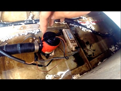 Positioning a bilge pump and float switch in a boat