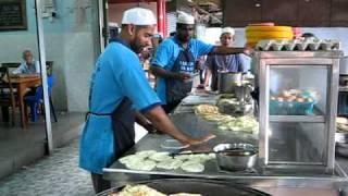 Making Roti Canai at Nasi Kandar Kampung Melayu, Penang