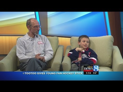 Tootoo gives young fan hockey stick