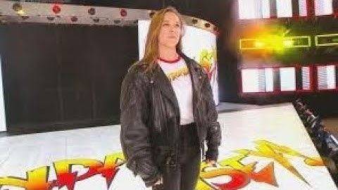 Ronda Rousey's contract signing at WWE elimination chamber