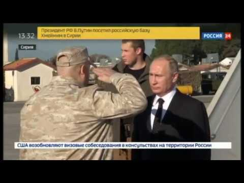 Putin, on visit, orders Russian forces to start pulling out of Syria