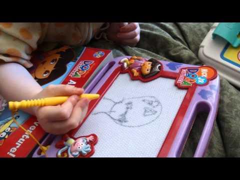 Jacklyn drawing Jack Skellington on her magnet boa...