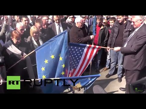 Serbia: Watch anti-NATO protesters burn EU & US flags