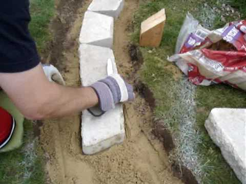 How to build a retaining wall  leveling tips  YouTube