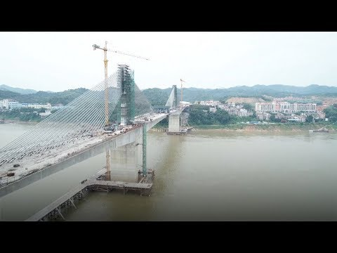 Cable bridge boasting of the largest span in Asia finishes connecting