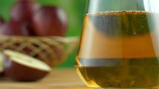 Closeup shot of fresh apple juice in a glass jug or a container - healthy fruits diet