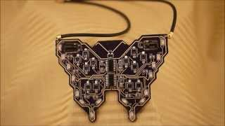 LUMEN Electronic Jewelry - Butterfly LED light up solar powered circuit board necklace