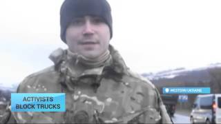 Activists Block Russian Trucks: Improvised checkpoints pop-up on Ukraine's western border