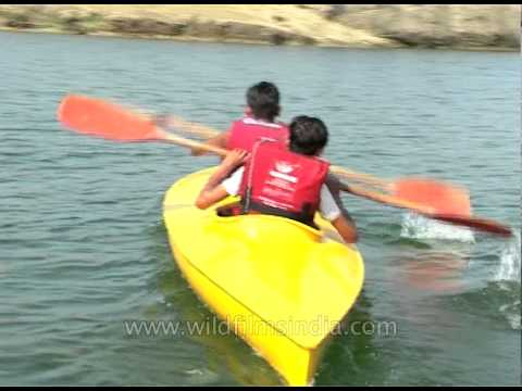 Kids Canoeing Paddling With A Double Bladed Paddle
