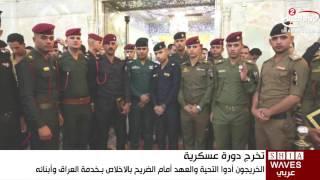 ضباط عراقيون يرددون قسم التخرج بضريحي الحسين والعباس