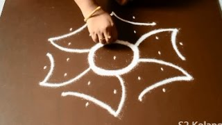 Video easy rangoli designs with 7 to 4 Dots - simple kolam withs dots - chukkala muggulu designs download MP3, 3GP, MP4, WEBM, AVI, FLV April 2018