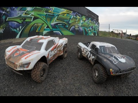 Losi Tenacity and Traxxas slash short course trucks ripping up the dirt track