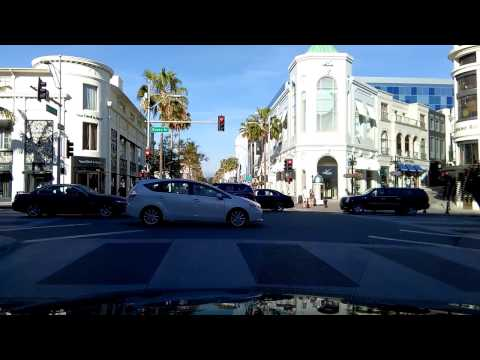 Driving Through Rodeo Drive, World Famous Beverly Hills, California Shopping Street.