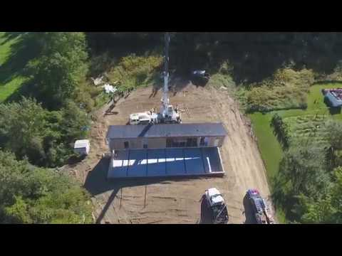 Didn't know you could do that!? Watch a mobile home crane lifted onto a basement foundation.