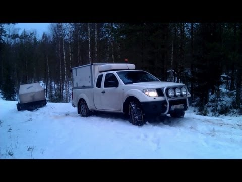 Nissan Navara Pickup Truck snow chains slippery winter road. King Cab tyre tire cables suv ice car