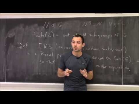 Characteristic random subgroups and their applications
