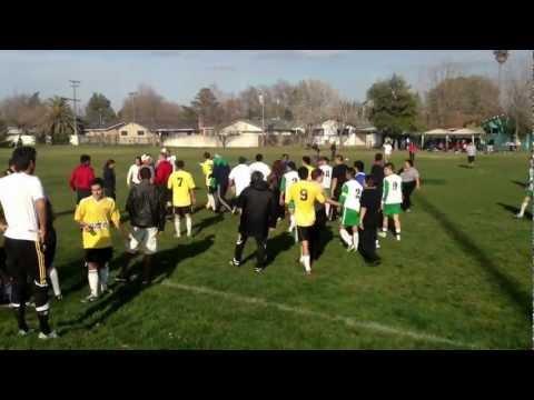 Brawl at CCSL soccer match in Dixon,Ca. Indios Dixon vs Academica.  Fan gets hit.